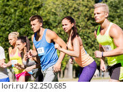 Купить «sportsmen with badge numbers on start of race», фото № 32250685, снято 16 августа 2015 г. (c) Syda Productions / Фотобанк Лори
