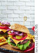 Купить «Hamburgers with cheddar cheese on a board», фото № 32250785, снято 14 июня 2019 г. (c) Oksana Zh / Фотобанк Лори