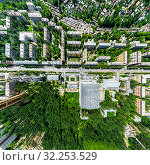 Купить «Aerial city view with crossroads and roads, houses, buildings, parks and parking lots. Sunny summer panoramic image», фото № 32253529, снято 21 января 2020 г. (c) Александр Маркин / Фотобанк Лори