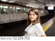 Купить «Woman waiting subway car on platform», фото № 32254753, снято 17 октября 2019 г. (c) Яков Филимонов / Фотобанк Лори