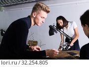 Student engaged in architectural modeling with groupmates. Стоковое фото, фотограф Яков Филимонов / Фотобанк Лори