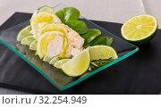 Купить «Ceviche from alaska pollock on a glass plate with lime and herbs», фото № 32254949, снято 14 октября 2019 г. (c) Яков Филимонов / Фотобанк Лори