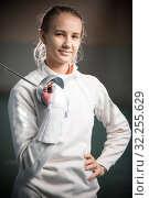 Купить «A portrait of a young woman fencer with a sword», фото № 32255629, снято 5 октября 2019 г. (c) Константин Шишкин / Фотобанк Лори