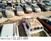 Купить «Aerial view new damaged cars due to flooding in dirt, spoiled can not be restored and used, gota fria September 2019, Orihuela, Torrevieja, Spain», фото № 32261489, снято 21 сентября 2019 г. (c) Alexander Tihonovs / Фотобанк Лори