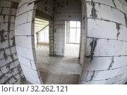 Купить «Empty doorframes and lightweight aggregate concrete blocks as material of walls, unfinished house», фото № 32262121, снято 29 мая 2016 г. (c) Кекяляйнен Андрей / Фотобанк Лори