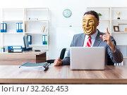 Купить «Businessman wearing mask in hypocrisy concept», фото № 32262453, снято 24 июня 2019 г. (c) Elnur / Фотобанк Лори