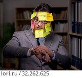 Купить «Businessman struggling with conflicting priorities during long h», фото № 32262625, снято 25 января 2017 г. (c) Elnur / Фотобанк Лори