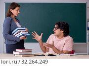 Купить «Old female teacher and male student in the classroom», фото № 32264249, снято 11 февраля 2019 г. (c) Elnur / Фотобанк Лори