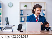 Купить «Young male businessman working in the office», фото № 32264525, снято 10 июня 2019 г. (c) Elnur / Фотобанк Лори