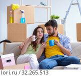 Купить «Young family moving to new apartment», фото № 32265513, снято 10 июля 2017 г. (c) Elnur / Фотобанк Лори