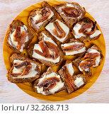 Купить «Toasts with salted anchovies and butter», фото № 32268713, снято 19 октября 2019 г. (c) Яков Филимонов / Фотобанк Лори