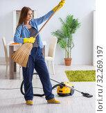 Купить «Young woman cleaning floor at home doing chores», фото № 32269197, снято 26 декабря 2017 г. (c) Elnur / Фотобанк Лори