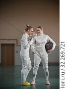 Купить «One young woman fencer laughing and another woman fencer looking at her», фото № 32269721, снято 5 октября 2019 г. (c) Константин Шишкин / Фотобанк Лори