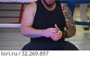 Big man is correcting his elastic bandage. Стоковое фото, фотограф Константин Шишкин / Фотобанк Лори