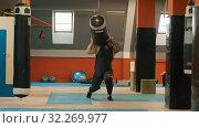 Купить «The sportsman is walking with punching bag on his shoulder», фото № 32269977, снято 5 июля 2020 г. (c) Константин Шишкин / Фотобанк Лори