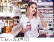 Купить «Woman looking for perfume», фото № 32270705, снято 31 января 2018 г. (c) Яков Филимонов / Фотобанк Лори