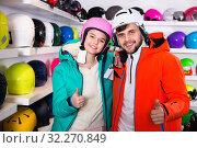 Купить «Man and woman standing with purchased ski equipment in shop», фото № 32270849, снято 6 февраля 2018 г. (c) Яков Филимонов / Фотобанк Лори