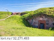 Купить «Old cannon and powder magazine on the island of Kustaanmiekka Suomenlinna Fortress (or Sveaborg), Helsinki, Finland», фото № 32271493, снято 23 мая 2019 г. (c) Юлия Бабкина / Фотобанк Лори