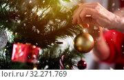 Купить «senior woman decorating christmas tree», видеоролик № 32271769, снято 12 ноября 2019 г. (c) Syda Productions / Фотобанк Лори