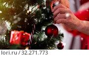 Купить «senior woman decorating christmas tree», видеоролик № 32271773, снято 13 ноября 2019 г. (c) Syda Productions / Фотобанк Лори