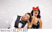 Купить «couple with party props on christmas or new year», видеоролик № 32271837, снято 18 ноября 2019 г. (c) Syda Productions / Фотобанк Лори
