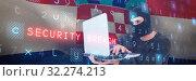 Купить «Composite image of focused burglar with balaclava holding laptop», фото № 32274213, снято 16 октября 2019 г. (c) Wavebreak Media / Фотобанк Лори