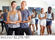 Купить «Couples enjoying dances in studio», фото № 32276181, снято 30 июля 2018 г. (c) Яков Филимонов / Фотобанк Лори