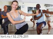 Купить «Group of happy adult people enjoying active dance in studio», фото № 32276201, снято 30 июля 2018 г. (c) Яков Филимонов / Фотобанк Лори