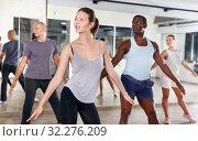 Купить «People dancing lindy hop during group training», фото № 32276209, снято 30 июля 2018 г. (c) Яков Филимонов / Фотобанк Лори