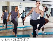 Купить «People practicing vigorous lindy hop movements in dance class», фото № 32276217, снято 30 июля 2018 г. (c) Яков Филимонов / Фотобанк Лори
