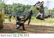 Купить «Dynamic paintball battle. Portrait woman player jumping and aiming marker on member», фото № 32276313, снято 22 сентября 2018 г. (c) Яков Филимонов / Фотобанк Лори