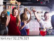 Купить «Group of joyful people clubbing in the club», фото № 32276321, снято 28 августа 2017 г. (c) Яков Филимонов / Фотобанк Лори