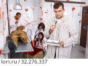 Guy frightening with medical instruments in quest room. Стоковое фото, фотограф Яков Филимонов / Фотобанк Лори