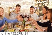 Купить «happy family having dinner party at home», фото № 32278421, снято 15 декабря 2018 г. (c) Syda Productions / Фотобанк Лори