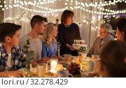 Купить «happy family having birthday party at home», фото № 32278429, снято 15 декабря 2018 г. (c) Syda Productions / Фотобанк Лори