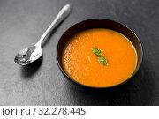 Купить «close up of vegetable pumpkin cream soup in bowl», фото № 32278445, снято 5 апреля 2018 г. (c) Syda Productions / Фотобанк Лори