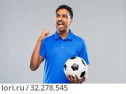 Купить «football fan with soccer ball celebrating victory», фото № 32278545, снято 8 сентября 2019 г. (c) Syda Productions / Фотобанк Лори