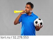 Купить «male football fan with soccer ball and vuvuzela», фото № 32278553, снято 8 сентября 2019 г. (c) Syda Productions / Фотобанк Лори