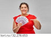Купить «happy woman showing euro money banknotes», фото № 32278653, снято 15 сентября 2019 г. (c) Syda Productions / Фотобанк Лори