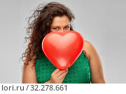 Купить «playful woman holding red heart shaped balloon», фото № 32278661, снято 15 сентября 2019 г. (c) Syda Productions / Фотобанк Лори