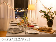 Купить «table served with plates, wine glasses and food», фото № 32278753, снято 15 декабря 2018 г. (c) Syda Productions / Фотобанк Лори