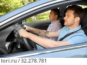 Купить «car driving school instructor and male driver», фото № 32278781, снято 25 августа 2019 г. (c) Syda Productions / Фотобанк Лори