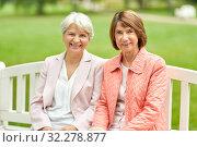 Купить «senior women or friends sitting on bench at park», фото № 32278877, снято 10 августа 2019 г. (c) Syda Productions / Фотобанк Лори