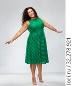 Купить «happy woman in green dress over posing», фото № 32278921, снято 15 сентября 2019 г. (c) Syda Productions / Фотобанк Лори