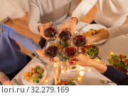 happy family having dinner party at home. Стоковое фото, фотограф Syda Productions / Фотобанк Лори