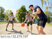 Купить «group of male friends playing street basketball», фото № 32279197, снято 21 июля 2019 г. (c) Syda Productions / Фотобанк Лори