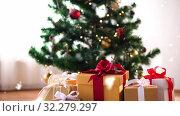 Купить «gift boxes on sheepskin near christmas tree», видеоролик № 32279297, снято 31 мая 2020 г. (c) Syda Productions / Фотобанк Лори