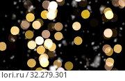 Купить «shimmering golden christmas lights and snow», видеоролик № 32279301, снято 22 октября 2019 г. (c) Syda Productions / Фотобанк Лори