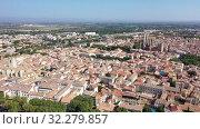 Купить «Scenic panoramic aerial view of residential areas of Narbonne with medieval Roman Catholic Cathedral on sunny summer day, France», видеоролик № 32279857, снято 30 августа 2019 г. (c) Яков Филимонов / Фотобанк Лори