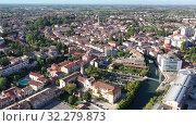 Купить «Scenic cityscape from drone of Italian town of Portogruaro in sunny day, Veneto, Italy», видеоролик № 32279873, снято 4 сентября 2019 г. (c) Яков Филимонов / Фотобанк Лори